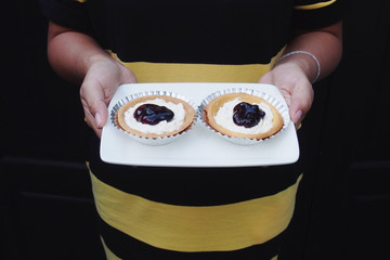 Blueberry cheese pie on hands