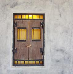 decorative window on the concrete wall