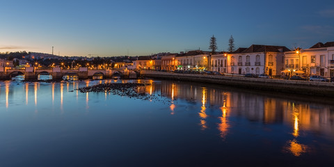 Old City of Tavira. At sunset. Arabic bridge.
