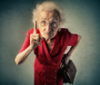 Angry grandma pointing out something - 75067118