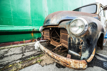 An old, American ruined car