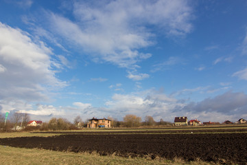 village, fields and sky