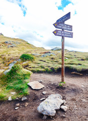 Signs pointing to the three lakes of Tristaina, Andorra