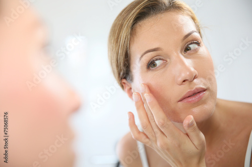 canvas print picture Middle-aged woman applying anti-aging cream