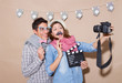 Young couple in a Photo Booth party with gesture face - 75068753