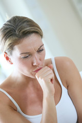 Middle-aged woman having a cold and coughing