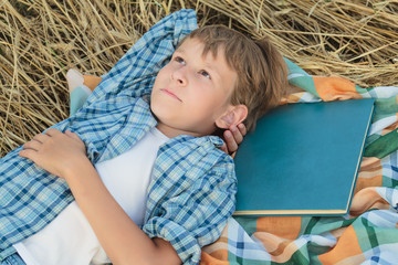 Teenage boy dreaming inspired by book