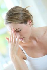 Portrait of woman suffering migraine
