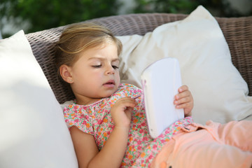 4-year-old kid playing with tablet