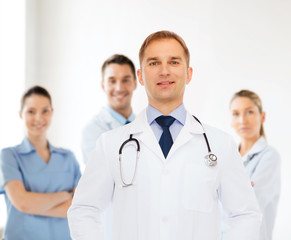 smiling male doctor with stethoscope