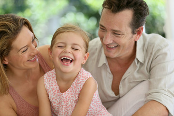 Portrait of happy family laughing together