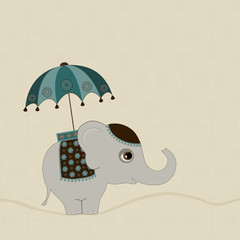 Cute indian elephant with umbrella