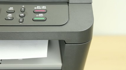 View of printer printing pages