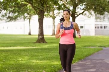 Fit brunette jogging in the park