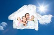 Composite image of happy young family looking up together