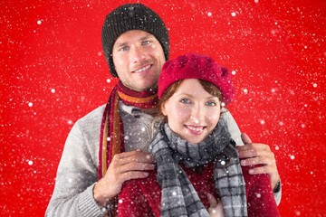 Composite image of couple smiling at the camera