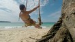 Woman On Swing On Tropical Beach