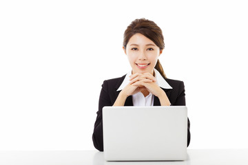smiling young business woman working with  laptop