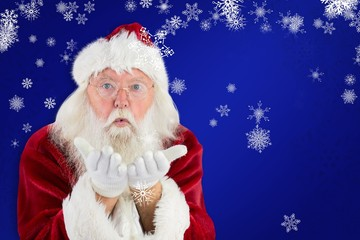 Composite image of santa claus blows something away