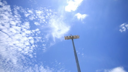 Stadium spot lights, clouds running background.