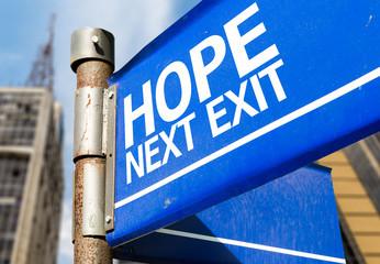 Hope Next Exit blue road sign