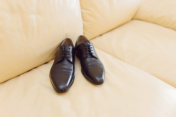 Shoes on Leather Bed