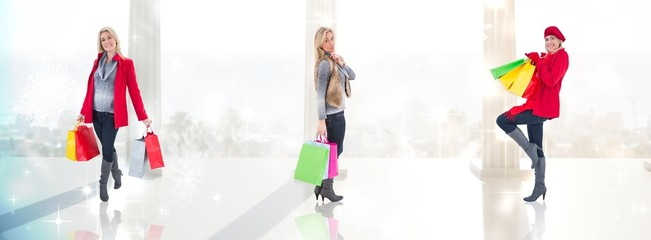 Happy blonde in winter clothes holding shoppng bags
