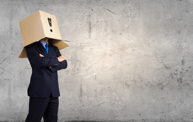 Man with box on head
