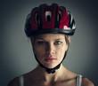 Woman wearing biking helmet. Close-up portrait of female cyclist
