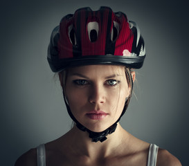 Woman wearing biking helmet. Close-up portrait of female cyclist