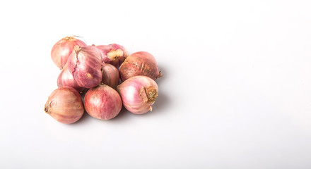 Indian small red onions over white background