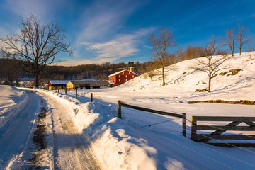 Fence and farm field along a snow-covered road in Seven Valleys,