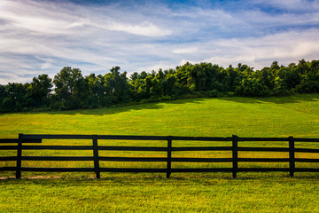 Fence and hill in rural York County, Pennsylvania.