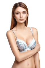 Pretty woman in bra, isolated on white background