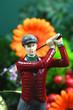Golfspielerfigur mit Blumen