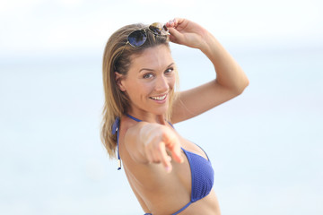 Beautiful woman in bikini showing thumbs up