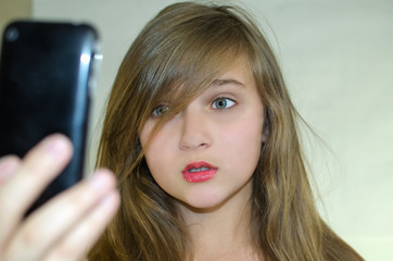 Girl taking pictures of himself on the phone
