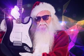Composite image of father christmas shows a guitar
