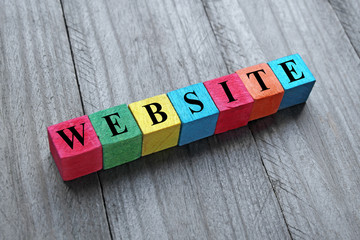 word website on colorful wooden cubes