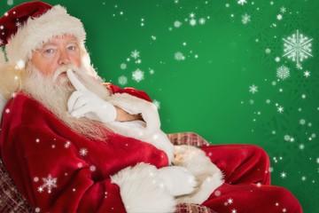 Composite image of santa asking for quiet