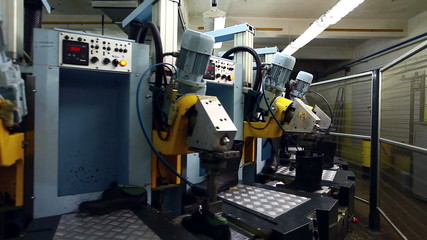 Modern machine in workshop of footwear production
