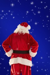 Composite image of rear view of father christmas
