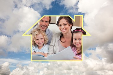Composite image of close up of a family looking at a photo album