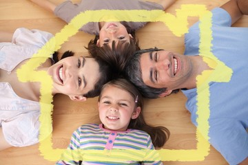 Composite image of lively family lying on the floor