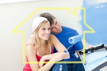 Composite image of affectionate couple painting a room