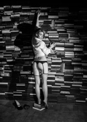 Nude sexy woman with book. Artistic black and white photo