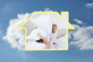 Composite image of girl hitting her father with pillow