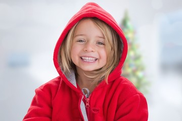 Composite image of cute girl in hooded jumper