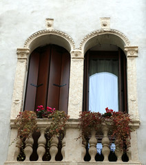 two balconies with Venetian-style terrace
