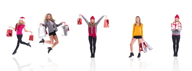 Composite image of festive blonde carrying gift bags